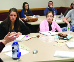 Dr. Jerry Zurek's ECG 200: Faces of Justice class discusses a reading assignment.  --sarah luckert by photo editor