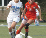 Cabrini midfielder Sammy Thompson battles for possession of the ball with Keystone midfielder Emily Burroughs. -- Sean Collins / Staff Writer