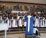 Cabrini's chorus rehearses for the upcoming winter concert on Dec. 4 at 3 p.m. in the Grace Hall Atrium.