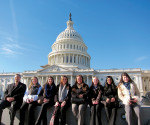 Students in Dr. Jerome Zurek's ECG300: Work Global Justice with CRS course, sit infront of the United States Capitol Building waiting to meet with their respective Senators and Representatives of the 112th United States Congress.