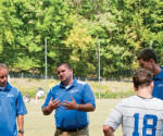Rob Dallas, center, stands next to former men's soccer head coach Glen Jaskelewicz during a team scrimmage. Dallas was recently promoted to head coach of the men's soccer program. -- Cabrini College Athletics Department