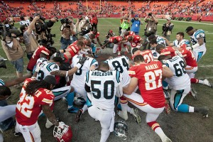 Players from the Kansas City Chiefs and Carolina Panthers gather at midfield for a prayer after the Chiefs 27-21 win on Sunday, Dec. 2, 2012. (MCT)
