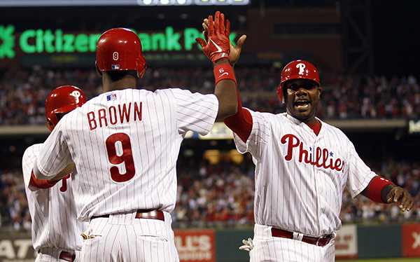 Ryan Howard and Domonic Brown (No. 9) could both be keys to the Phillies success in 2013. Spring training for the 2013 season begins on Tuesday, Feb. 12. (MCT)