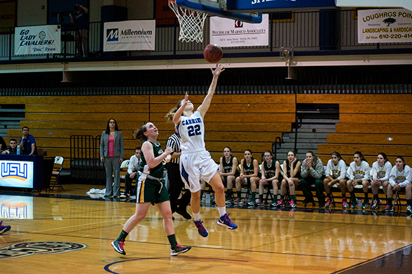 Brittany Sandone (No. 22) completes a lay-up for two of her 13 points in Cabrini's 66-40 win over Marywood University on Saturday, Feb. 16. (Dan Luner / Staff Photographer)