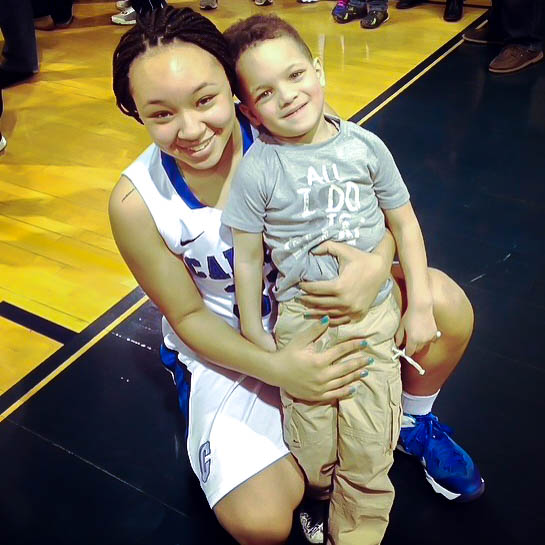 Sophmore guard Tayler Holmes celebrates win with her five year old son.